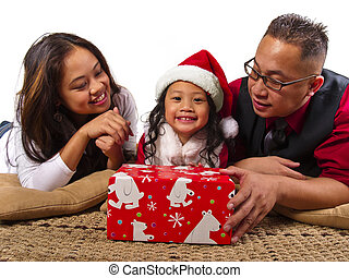 Christmas Family - Filipino family with a red gift box on...