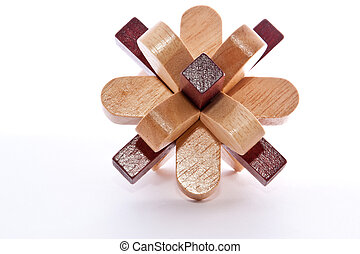 Wood Burr - Two colored wooden burr puzzle assembled on...