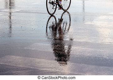 cyclists in the rain, a symbol of bad weather, accident...