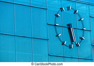 clock on a building - a large clock on a modern building