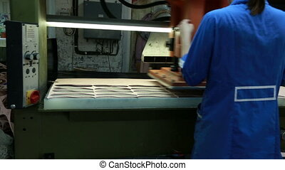 View of worker woman making insoles using press. Footwear...