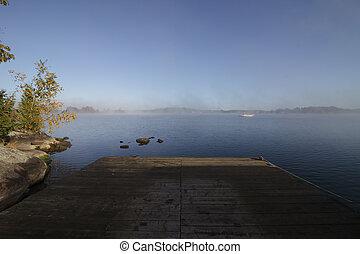 Dock on a Foggy Calm Morning
