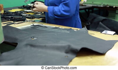 Workshop for production of shoes. Cutting leather