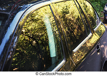 Beautiful natural scene reflected on the car - Reflection of...
