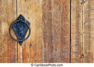Circle doorhandle - Closeup image of old wooden door with...