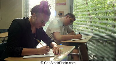Students doing their school work - High school students...