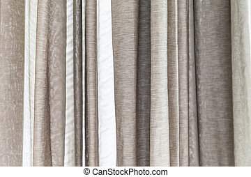 White and gray curtains at the windows for background