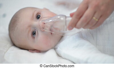 Respiratory Therapy - Baby taking respiratory therapy Hand...