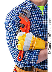construction worker holding monkey wrench in hand with...
