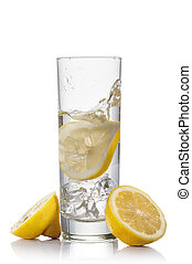 water and lemon - glass full of fresh water with lemon and...