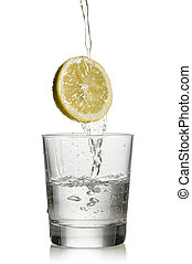 water and lemon - water flowing over lemon and fill a glass...