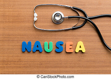 nausea colorful word on the wooden background