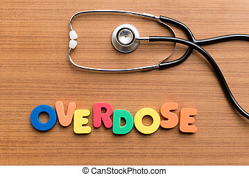overdose colorful word on the wooden background