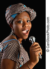 African song - Singing young Ghanese african woman against a...