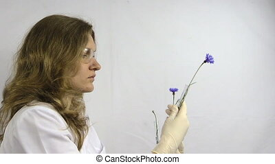 researcher woman plant - Researcher woman with protective...