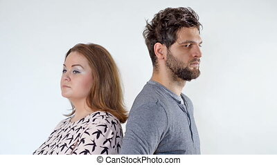 Young couple playing as pretenders on white background