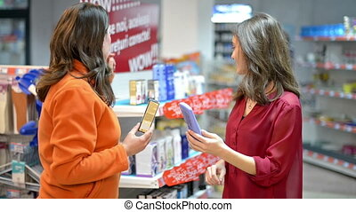 Customer choosing cosmetic products in supermarket talking...