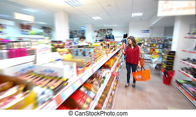 Customers choosing products in supe - Happy woman with...