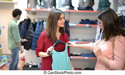 Satisfied customer holding clothes - Happy woman showing...