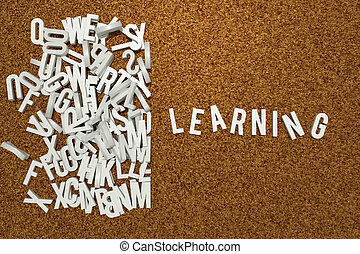 corkboard - corckboard with white letters composing learning...