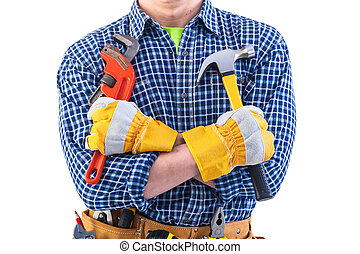 very close up view tools in crossed arms of worker isolated on w