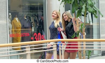 Three girls on a shopping: meeting friends.