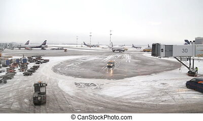 Passenger planes winter airport working