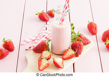 Milk with fresh strawberries - Vintage glass bottle with...