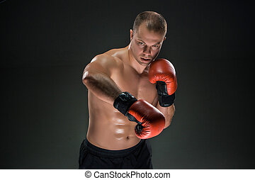 Young Boxer boxing - Young boxer in red gloves boxing over...
