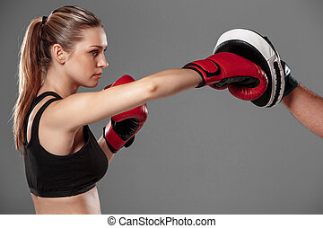 beautiful woman is boxing on gray background - beautiful...