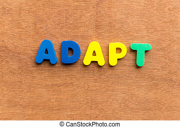 adapt colorful word on the wooden background