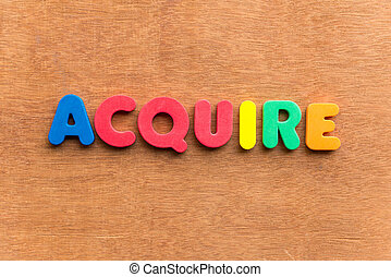 acquire colorful word on the wooden background