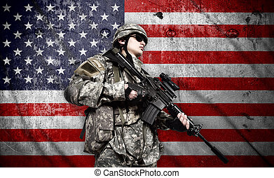 soldier on american flag background - soldier holding rifle...