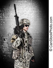 soldier with rifle isolation on gray background
