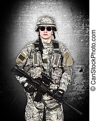 US soldier with rifle isolation on gray background