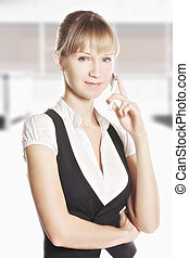 Confident caucasian woman on phone at office