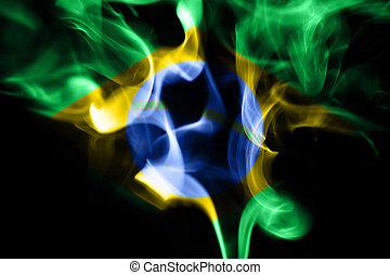 colored smoke on a black background with brazilian flag -...