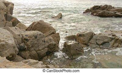 Virgin Beach Rocks at Sunrise - Typical Mediterranean beach...