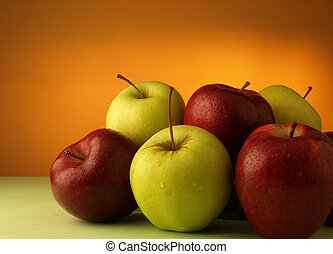 red and green apples on a colored background