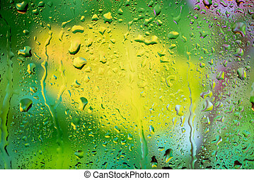 water drops on glass - bright abstract background of water...