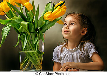 flower girl - little girl and yellow tulips