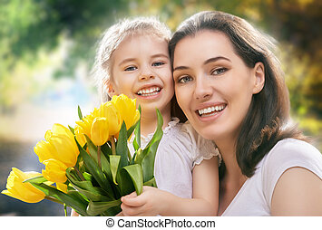 sunny day - happy mother and child together