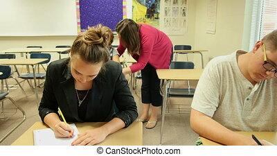 Teacher helping students UHD 4k - High school teacher...