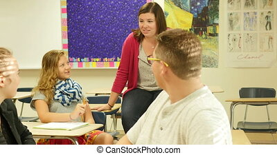 Teacher having a discussion class - A high school teacher...