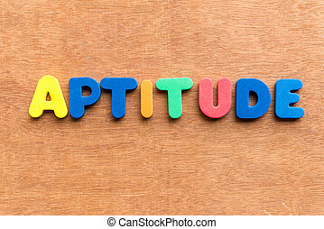aptitude colorful word on the wooden background