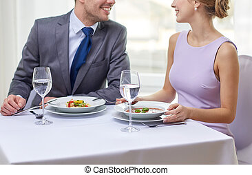 close up of couple talking at restaurant - restaurant, food,...