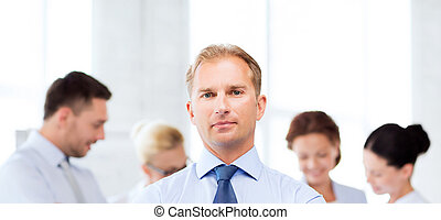 handsome businessman with team in office - picture of...