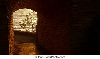 Sunrise Golden Waters at the Tunnel - Golden sun light over...
