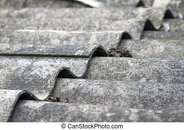 The roof of an old house covered with gray tiles