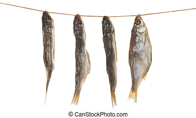Dried fish on a rope - four delicious salted fish hanging in...